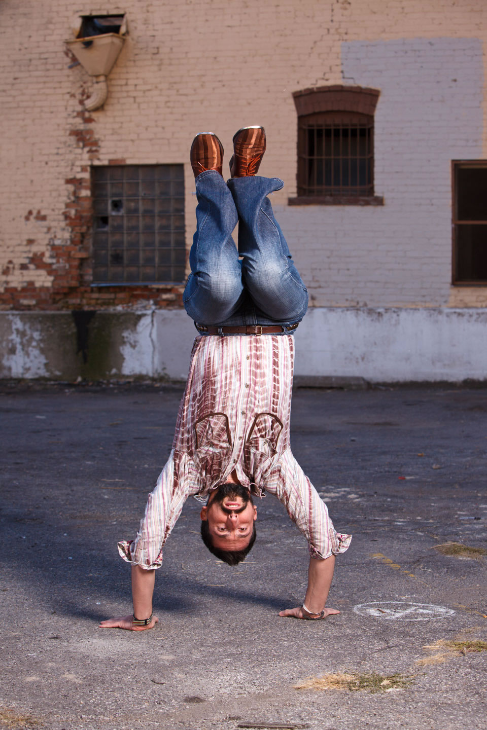 Aaron demonstrates capoeira with a handstand