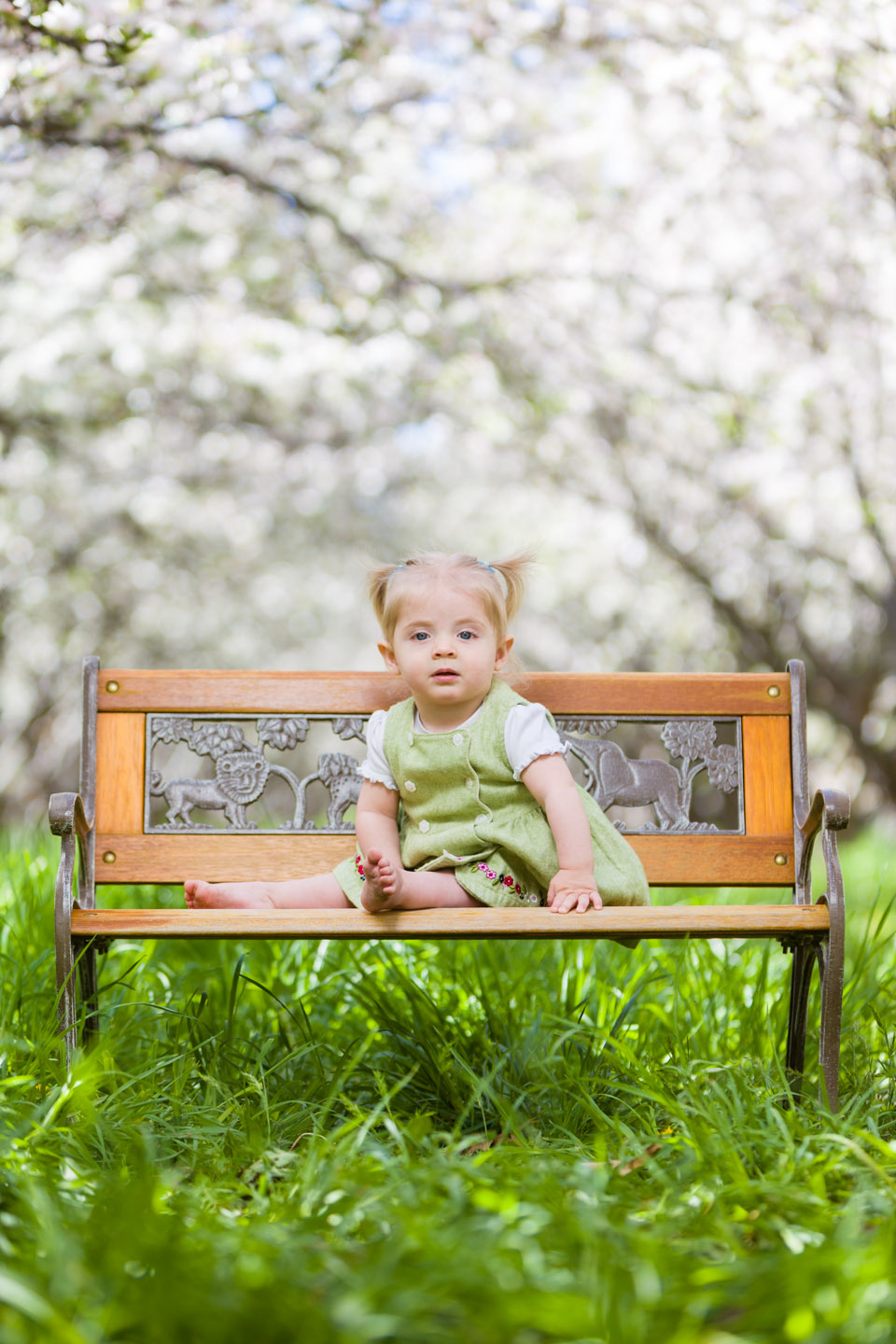 Eve sits on a garden bench in the Orchard
