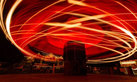 A long exposure of a carnival right at night. Light dancing in streaks.