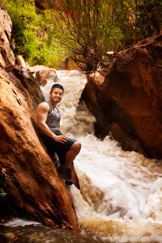 Man stands in Kanarraville Creek Waterfalls