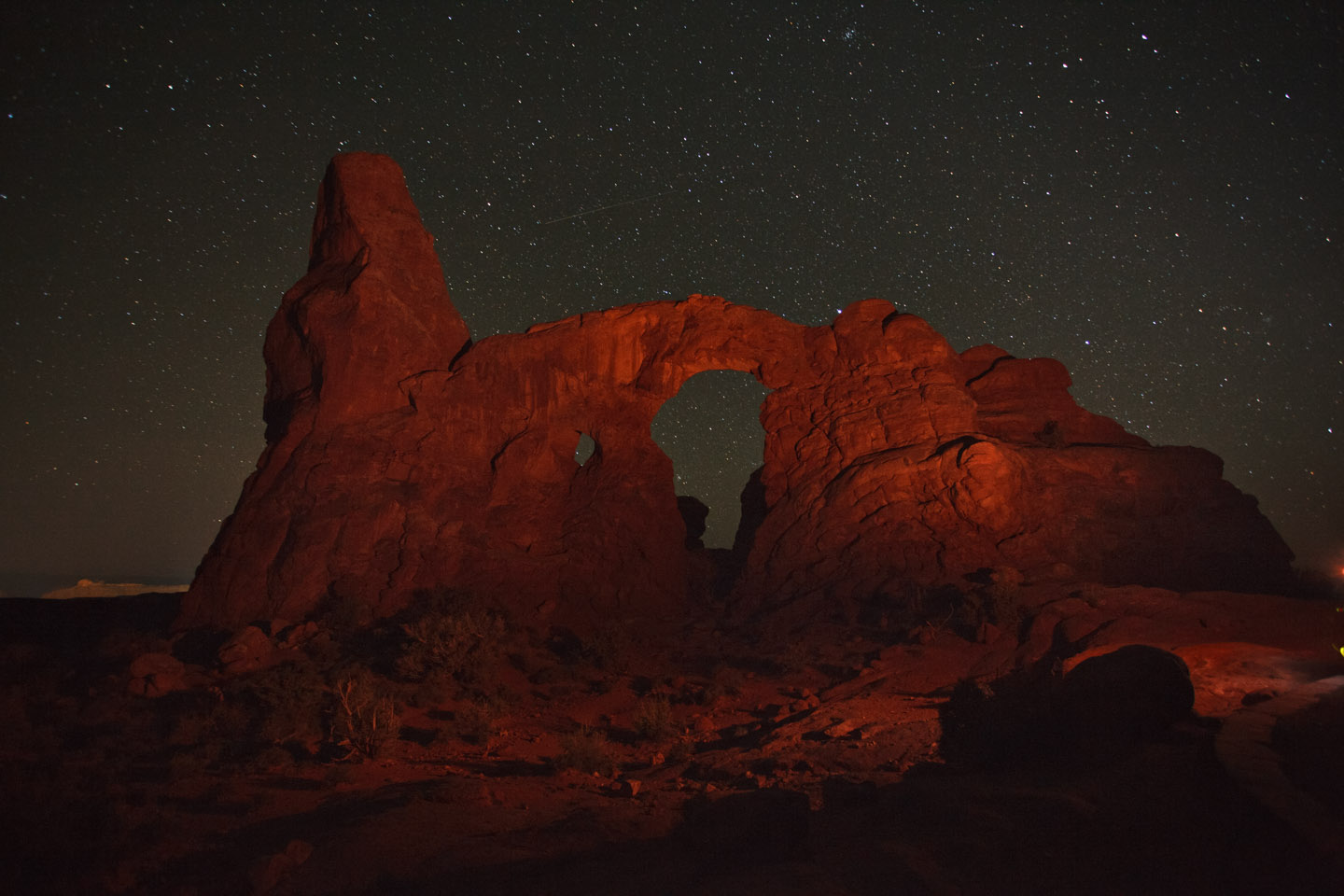 Night Stars and light painting over Turret Arch in Moab