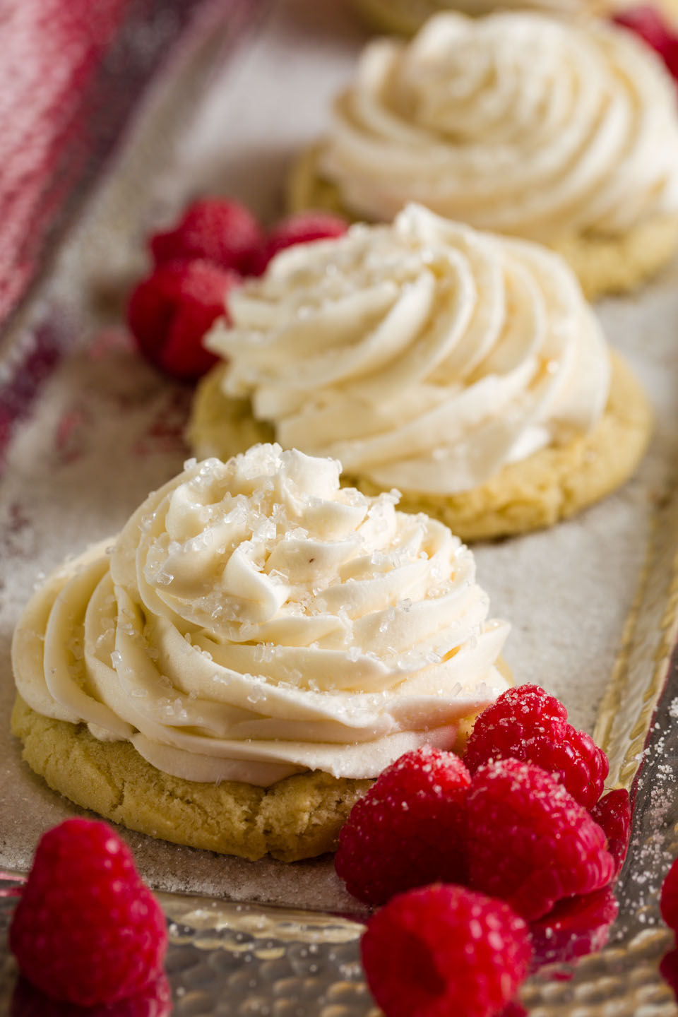 Frosted cookies with raspberries