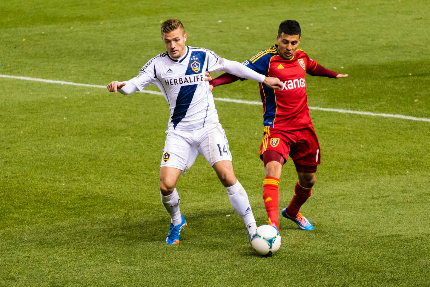 Robbie Rogers and Tony Beltran fight for the soccer ball