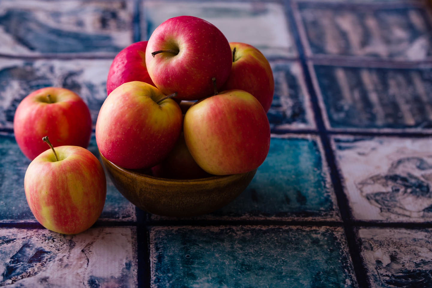 Apples in pottery and a vinyl prop that looks like blue tile