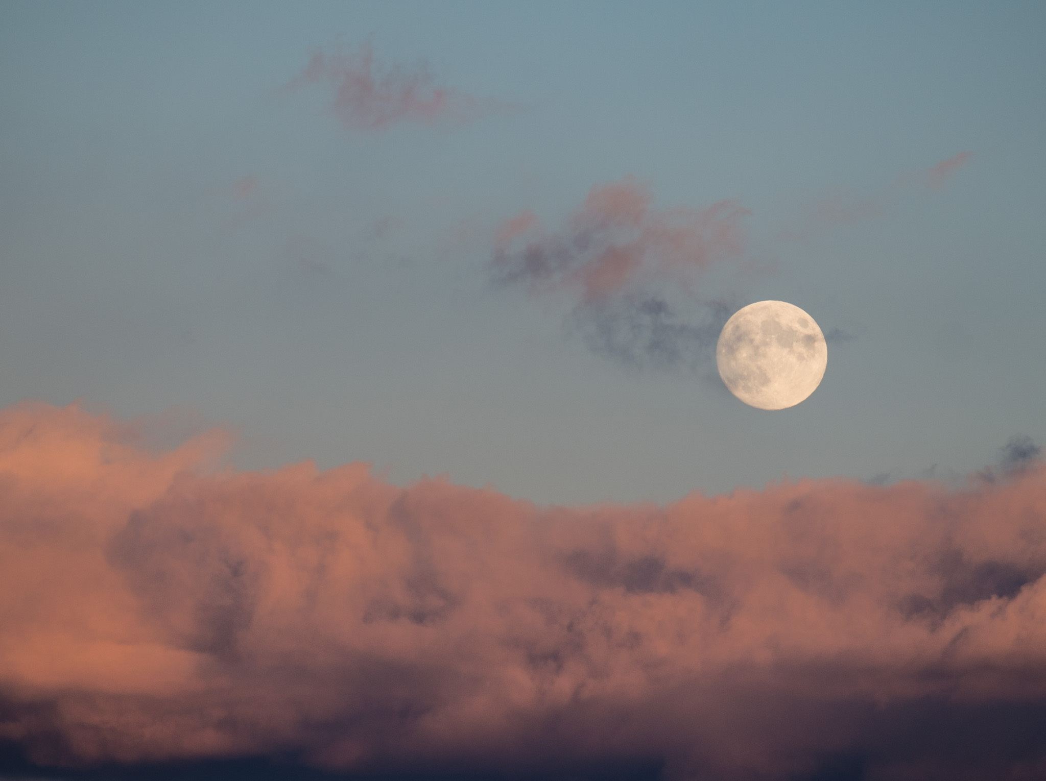 Moon over turbulent clouds