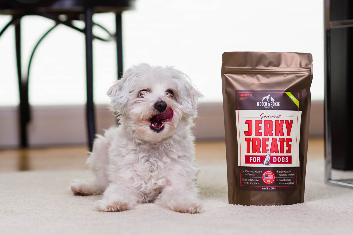 A dog licks his lips after enjoying the jerky treats