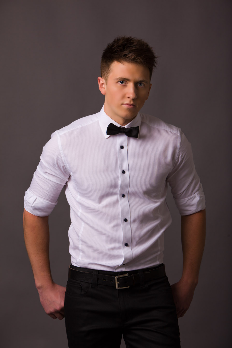 Using the large studio lights. Model is dressed formal with bow tie