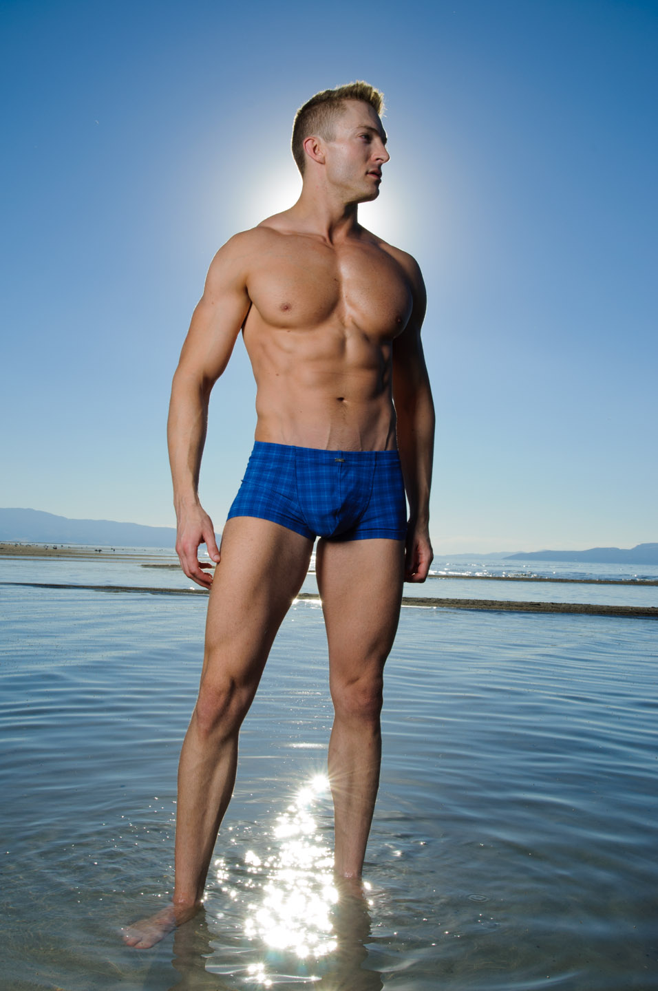 Blue swim trunks and male model in the great salt lake