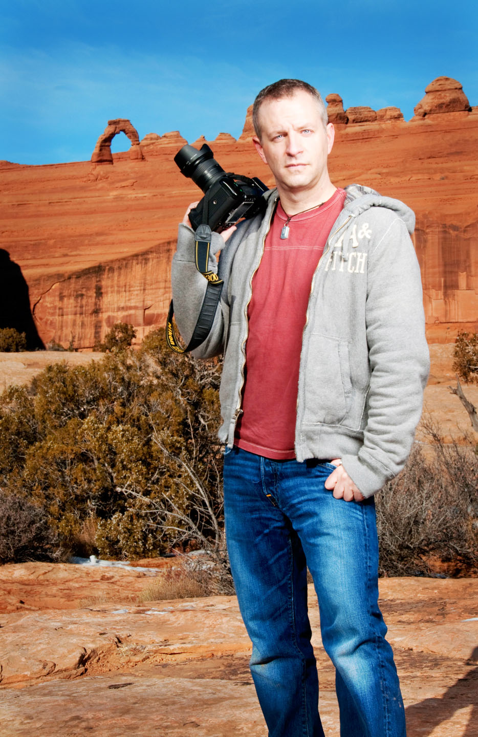 dav.d by David Newkirk and photographed in Moab in front of the Delicate Arch
