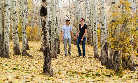 Walking through an aspen grove for engagement photos