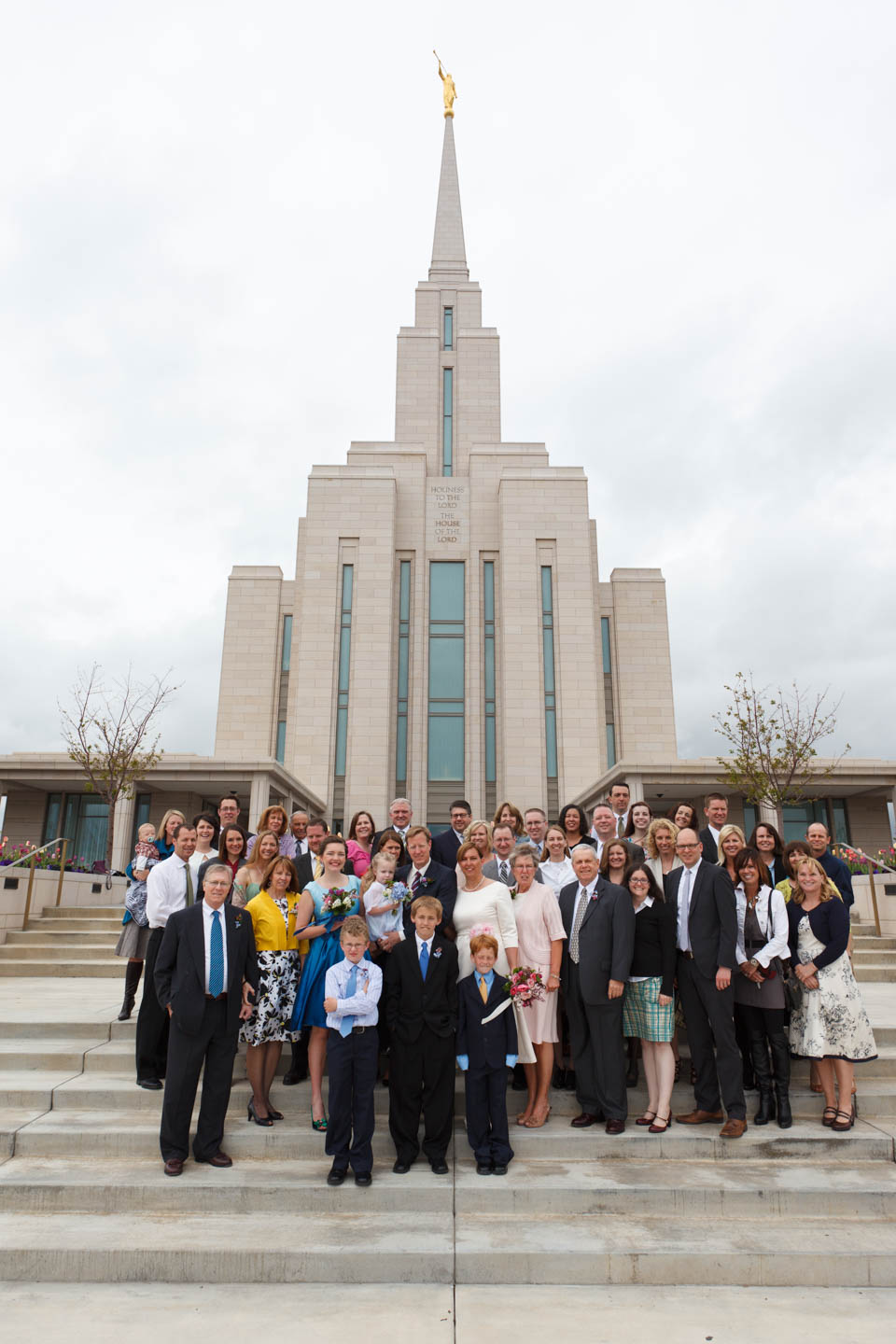 The whole group of family and friends in front of the Oquirrh Mountain Temple