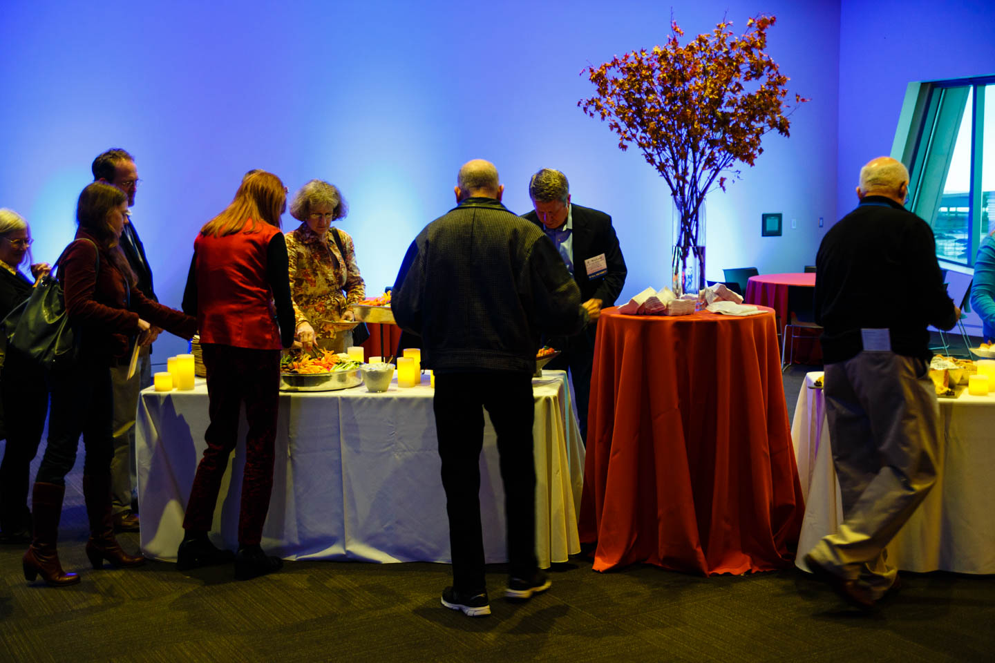 Folks enjoy the heck out of the buffet by Le Croissant Catering
