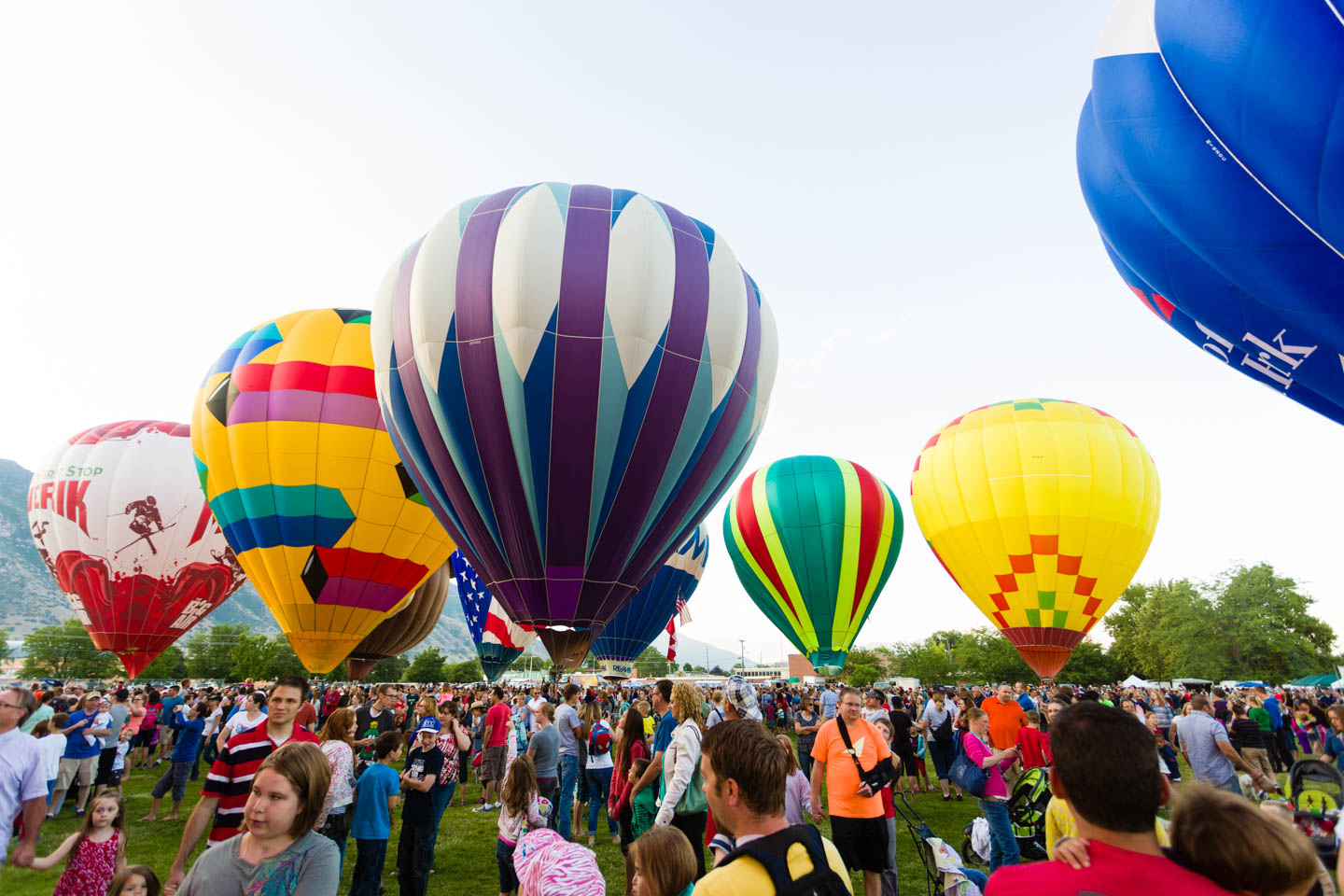 People tour the hot air balloons