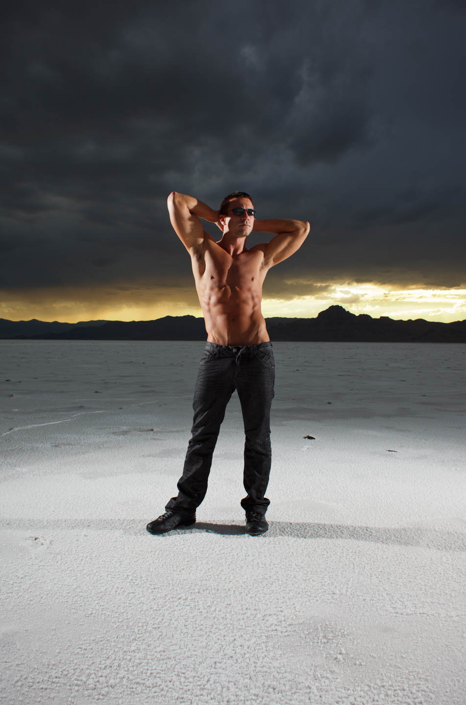 Creative lighting for a muscled male model on the Bonneville Salt Flats