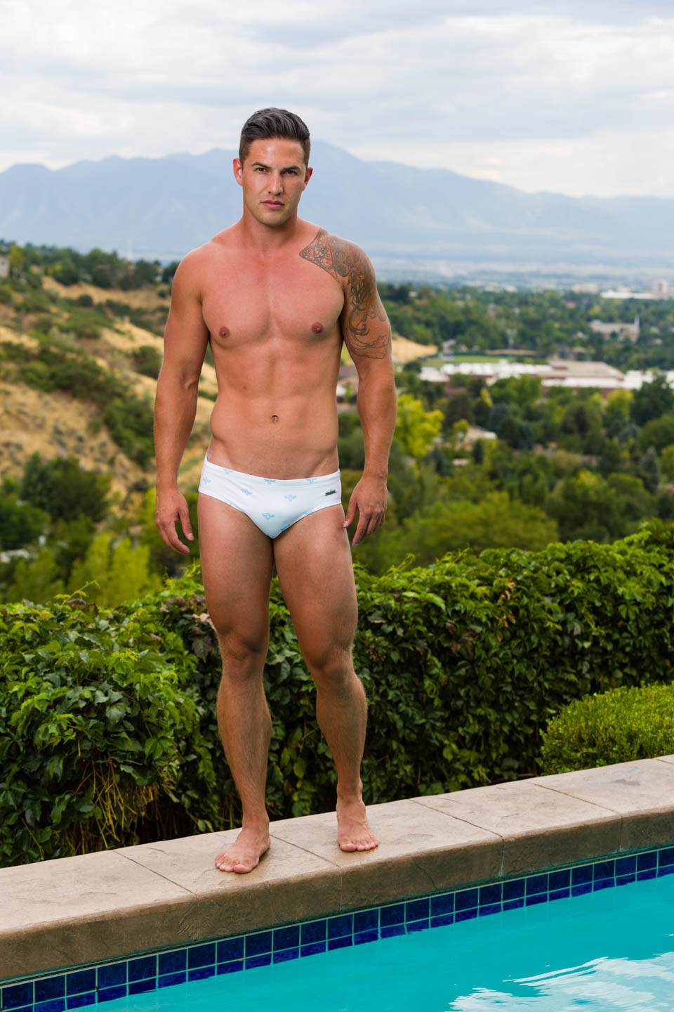 Luke models Aronik Quorum White swimwear