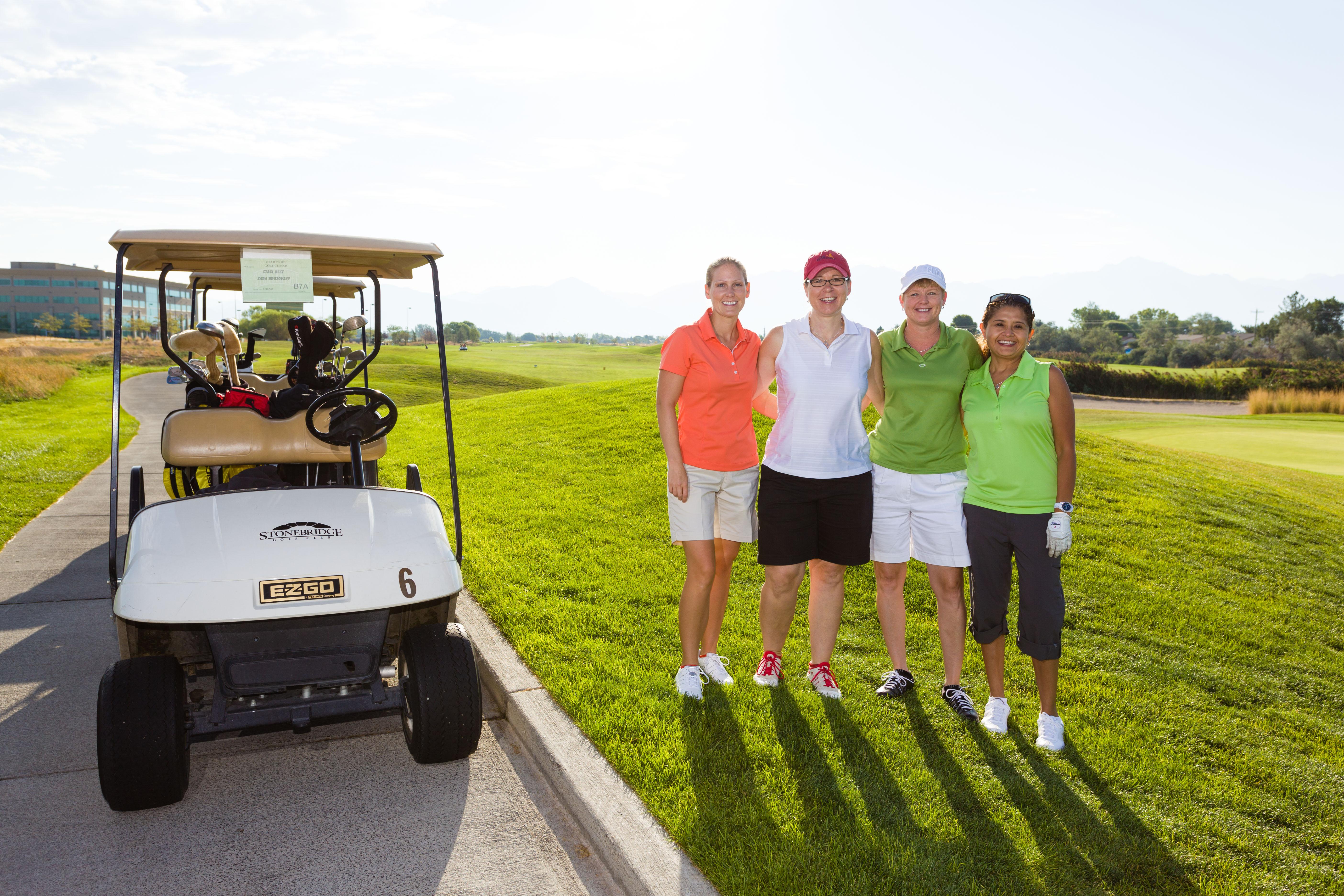 A golf team poses for their team portrait