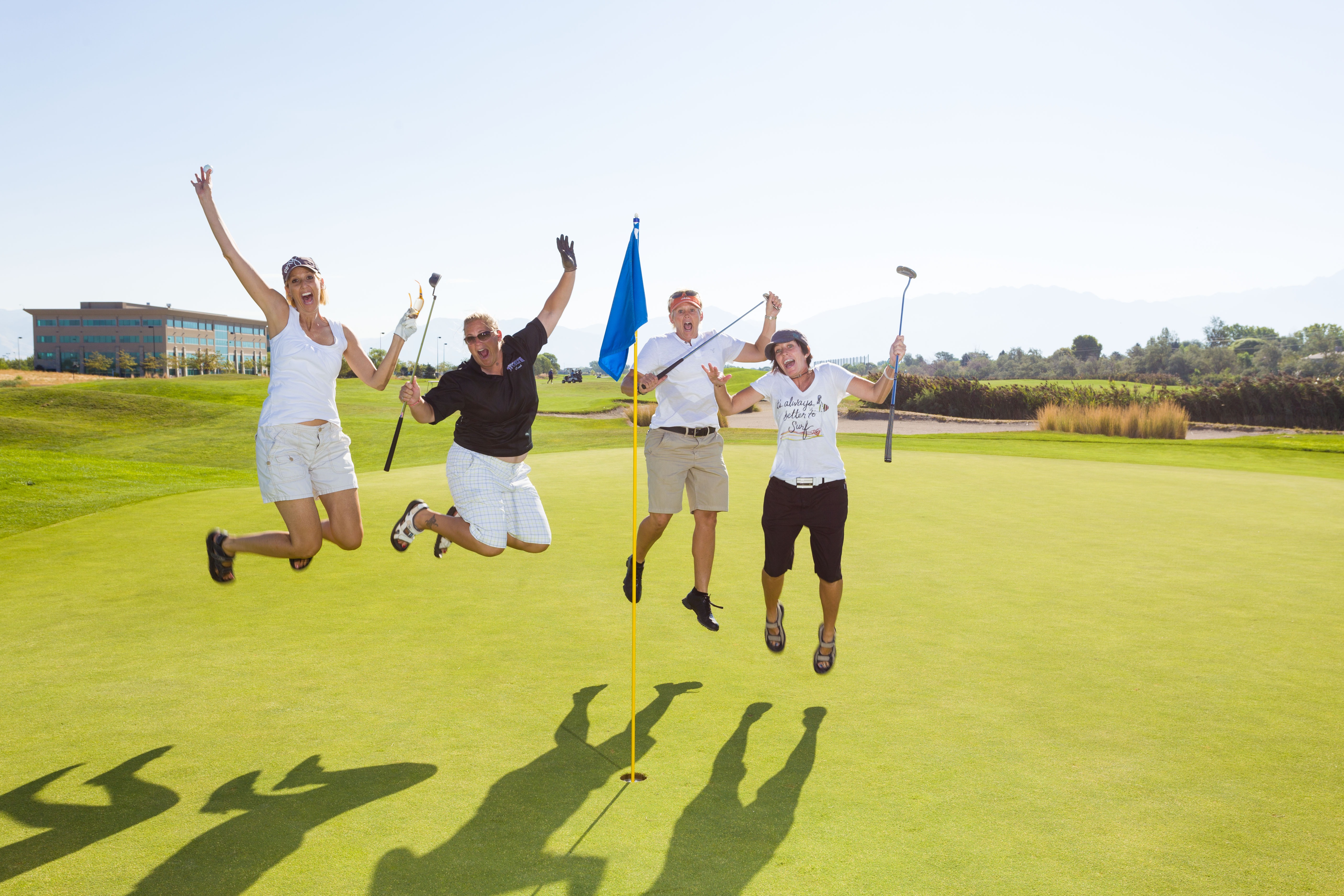 Golfers jump for joy