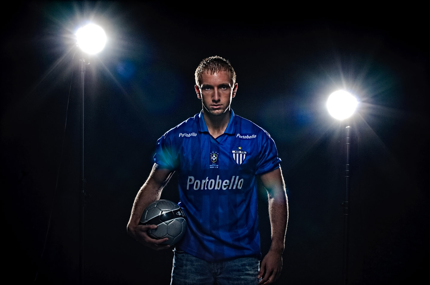 Creating stadium lighting in studio for a soccer portrait