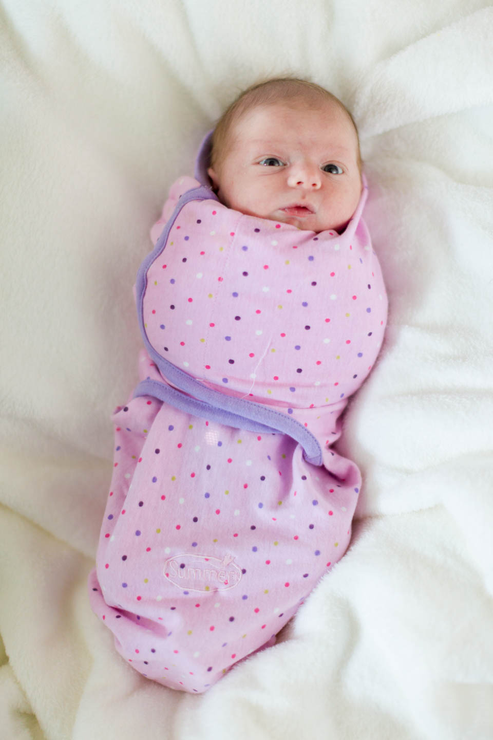 Baby Britain is bundled in a pink blanket