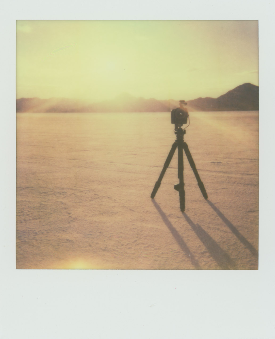 Camera and tripod on the Bonneville Salt Flats. Shot with The Impossible Project Film