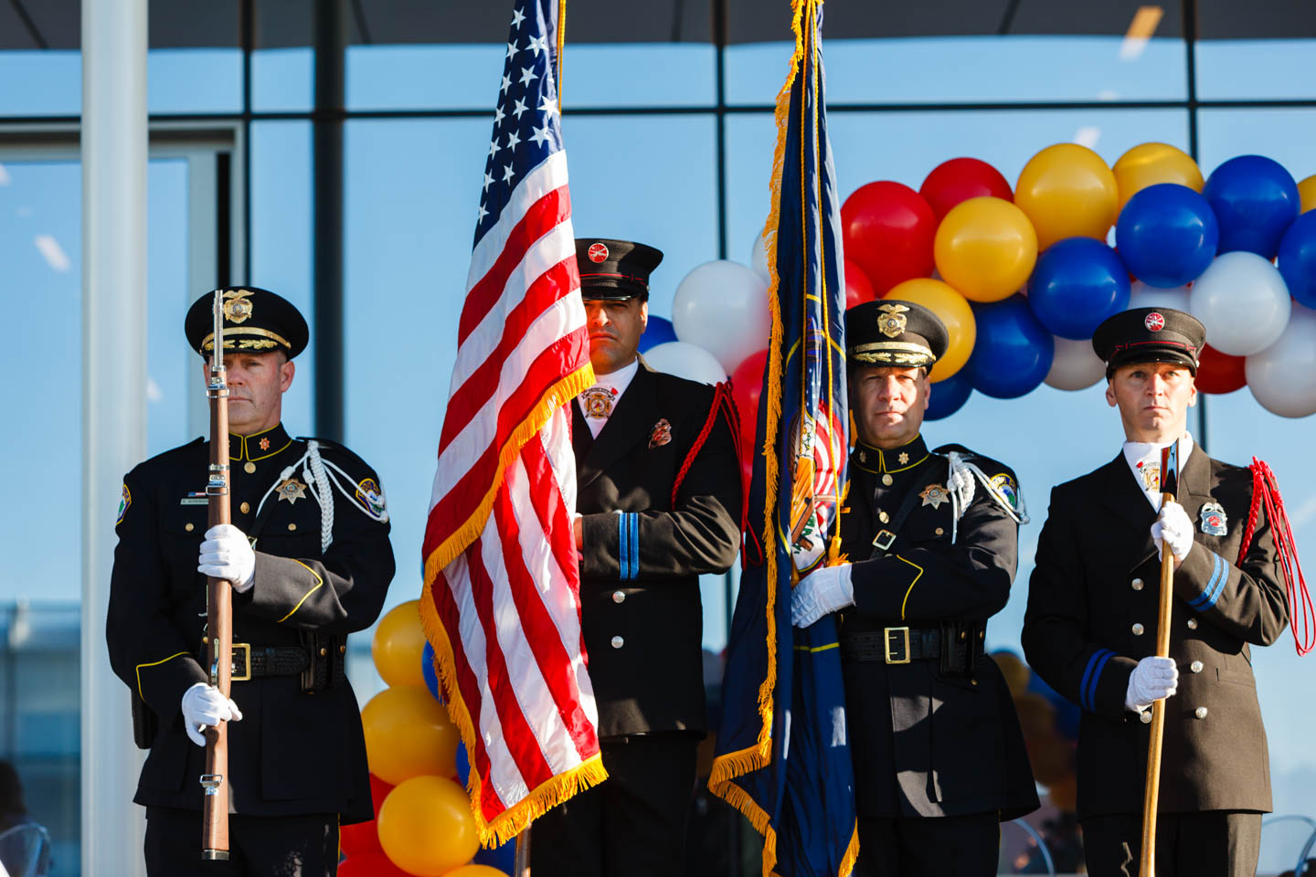 The Color Guard of police and fire department and emergency services