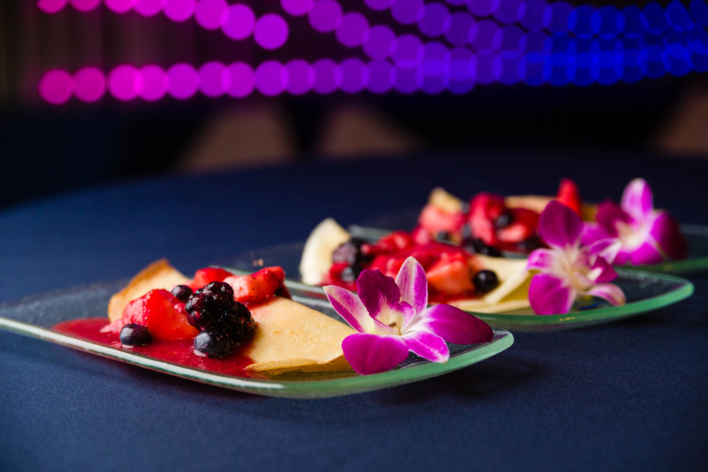 Berries Crepes and an edible flower for dessert