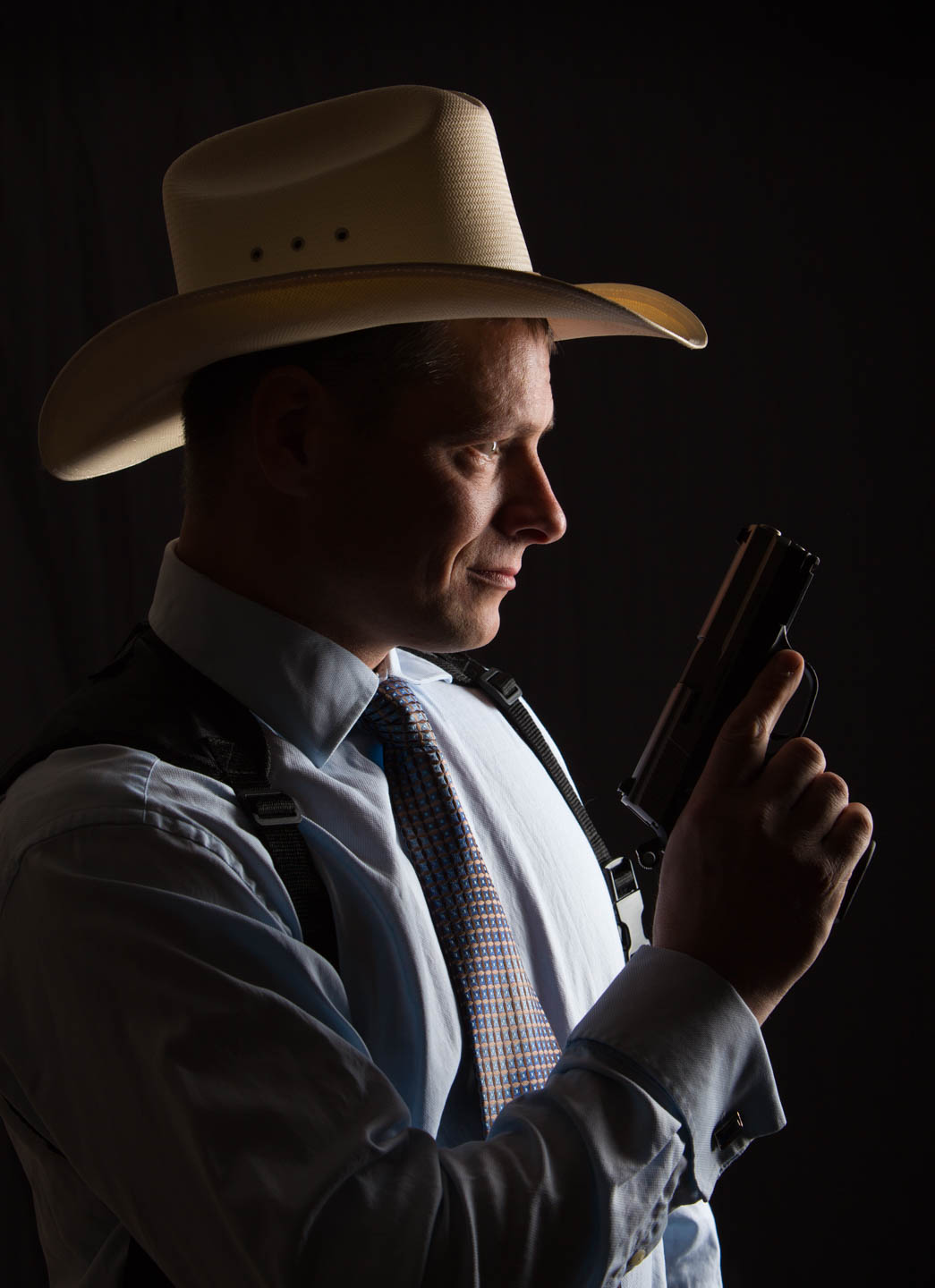 Erno loves the cowboy look and the second amendment so we photographed him and the gun