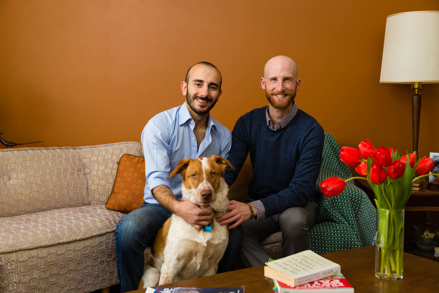 A family photo of Derek Kitchen and Moudi Sbeity and their dog Goji