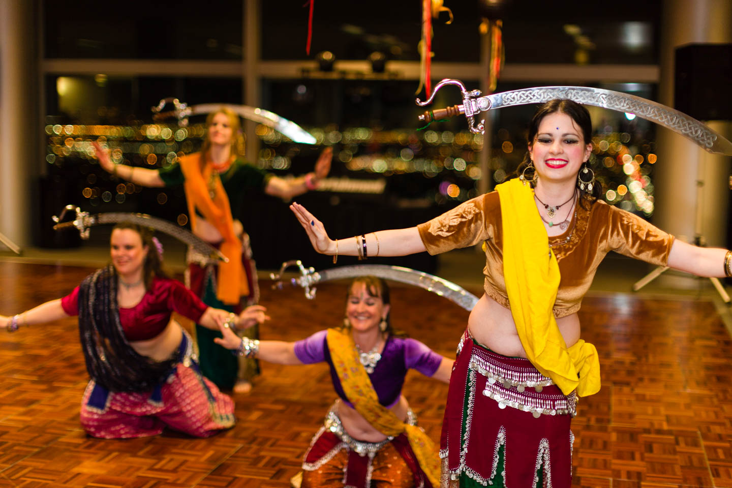 Belly dancers balance swords on their heads