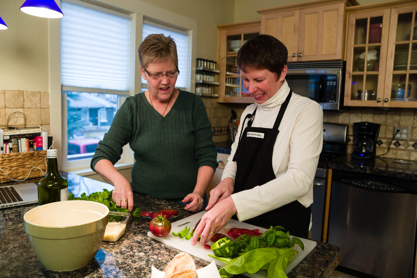 Kody Partridge and Laurie Wood in the kitchen preparing lunch