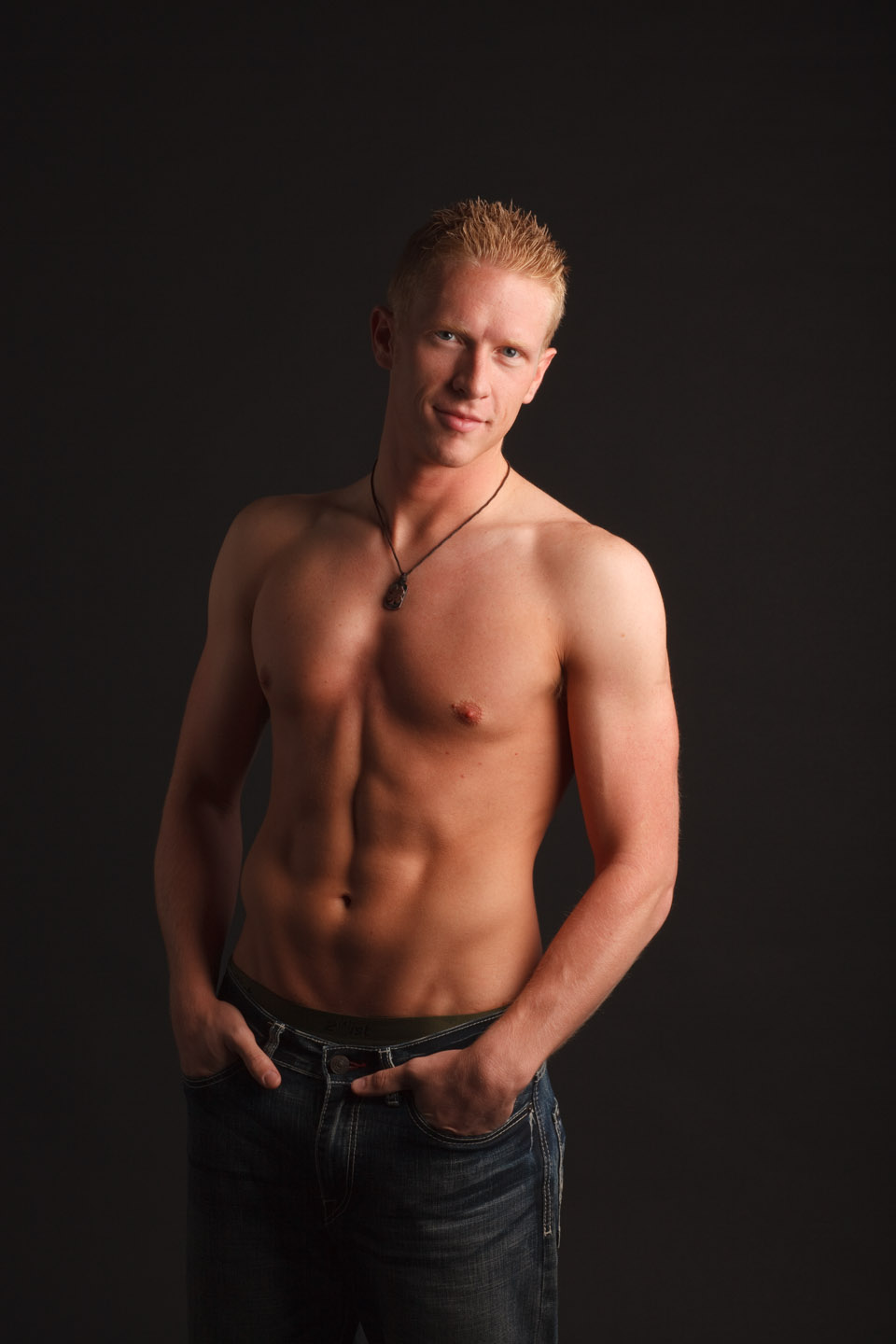 Male model shirtless portraits in studio