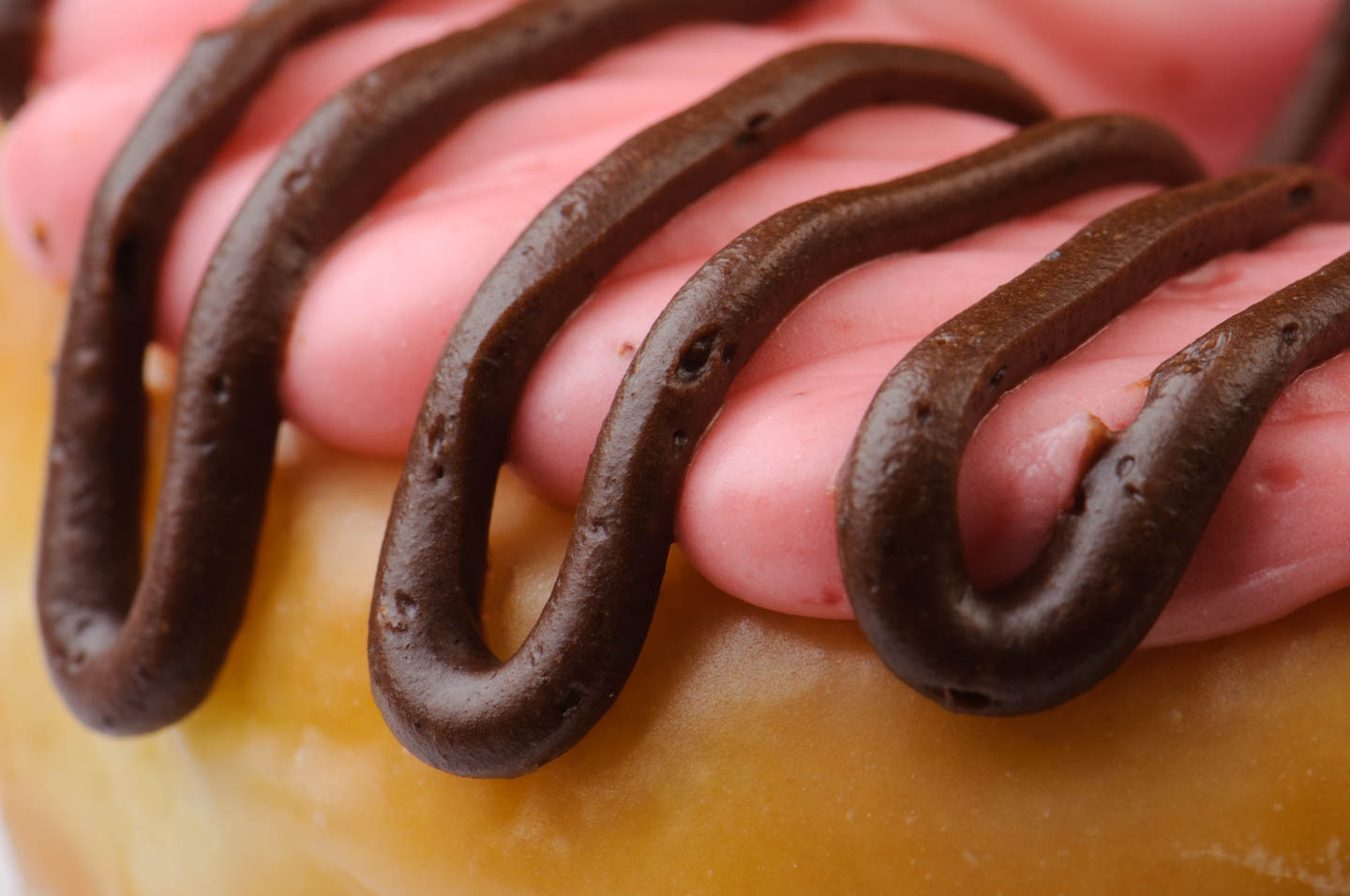 A close up view of the raspberry and chocolate frosting