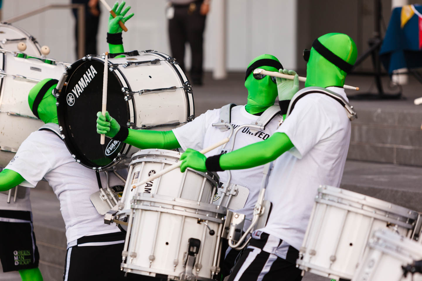 UVU Green Man Group play drums for the volunteers
