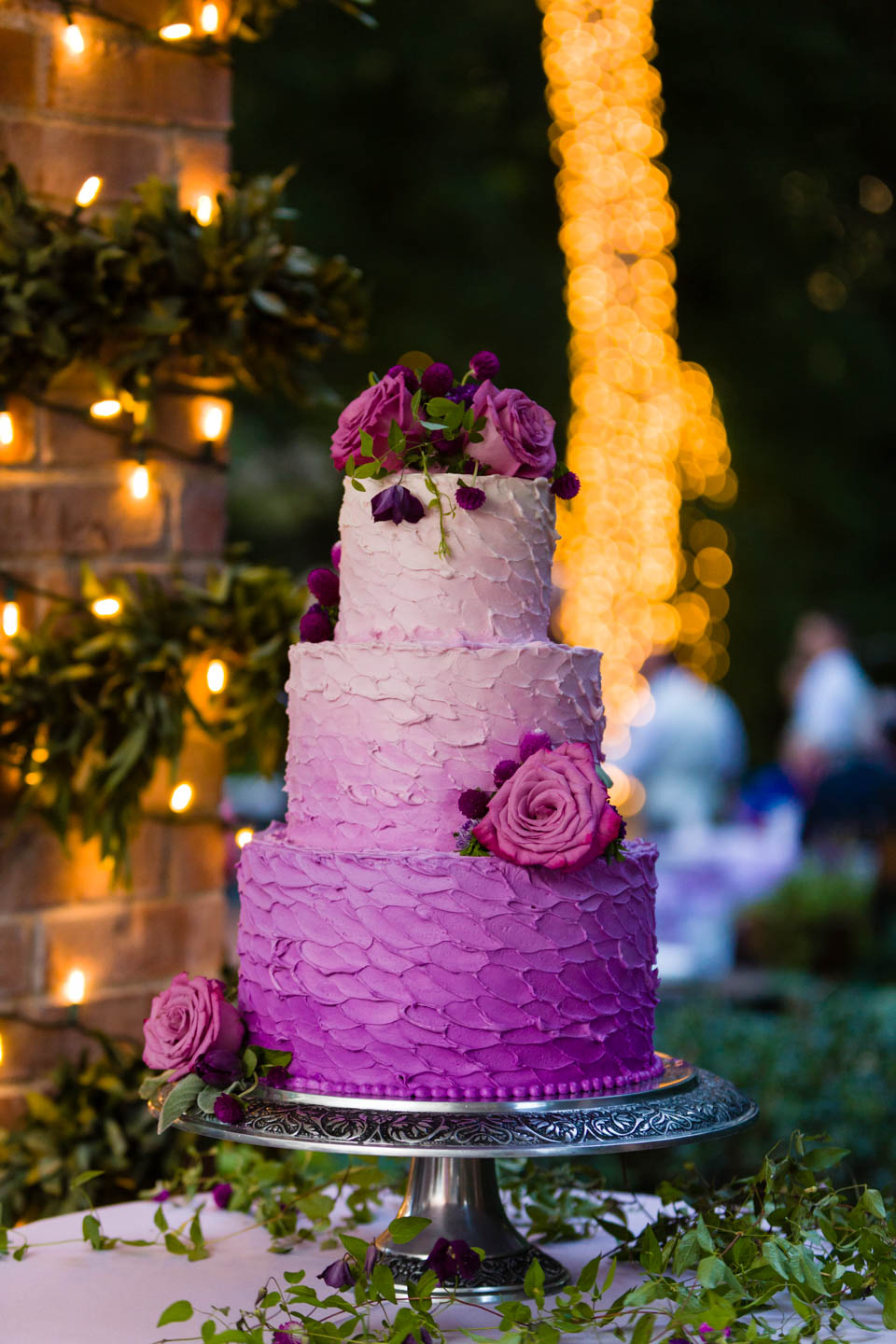 Wedding cake at night with Christmas lights
