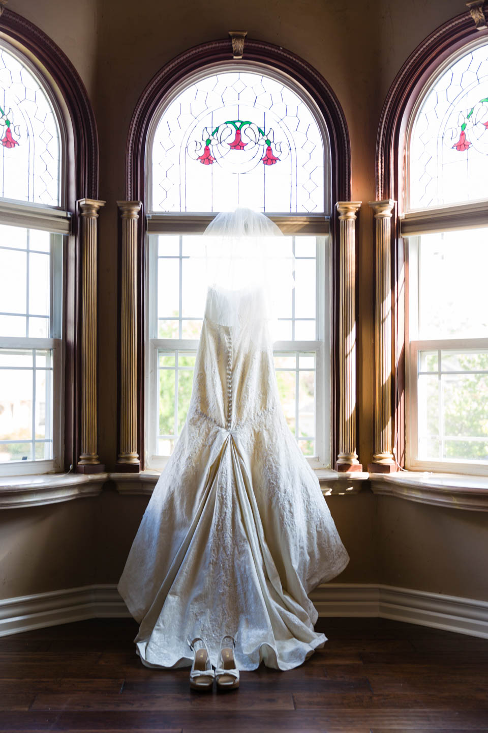 Wedding dress hangs in the window