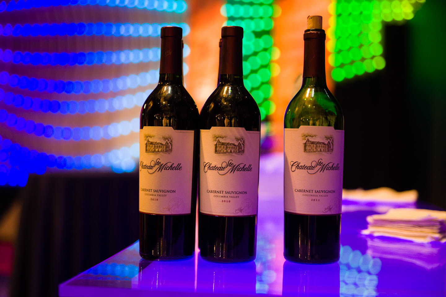 Wines for the evening with neon lights in the background