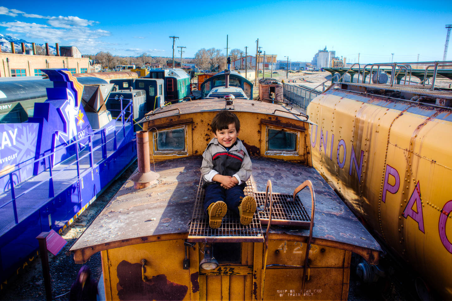 Alexander sits a top a train's caboose thanks to Photoshop