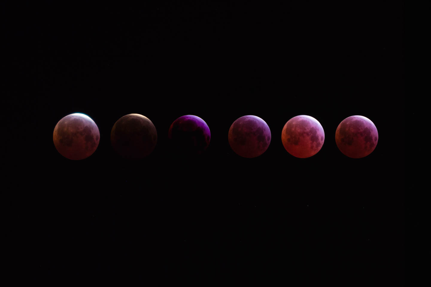 Several stages of the full lunar eclipse with red moon