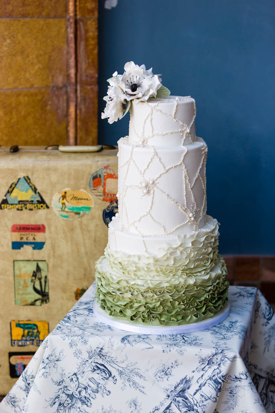 Wedding Cake and an antique suitcase