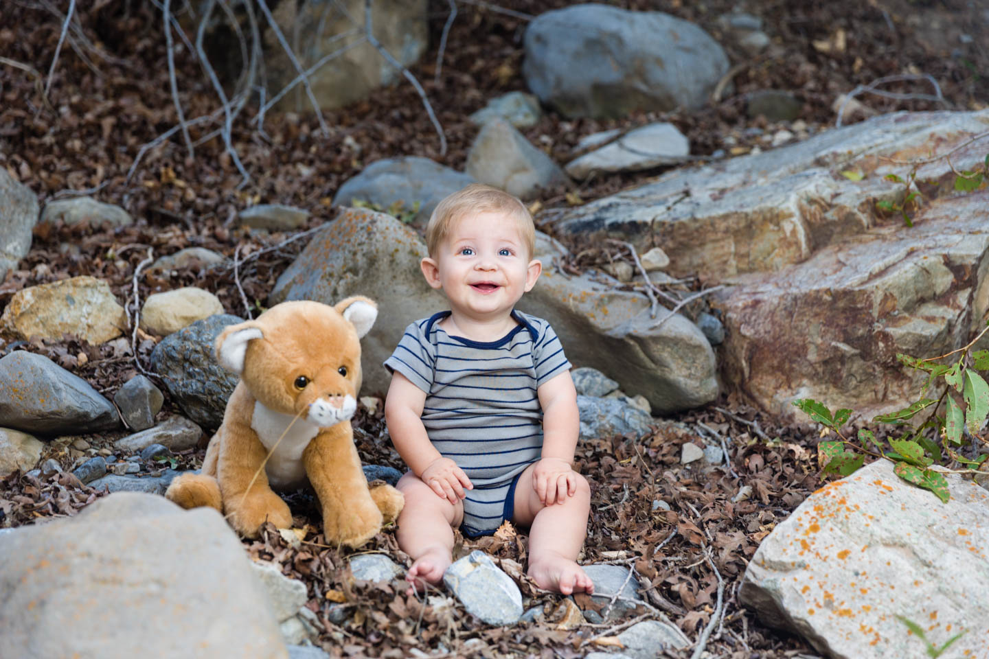 Levi poses next to his cougar for his monthly portrait