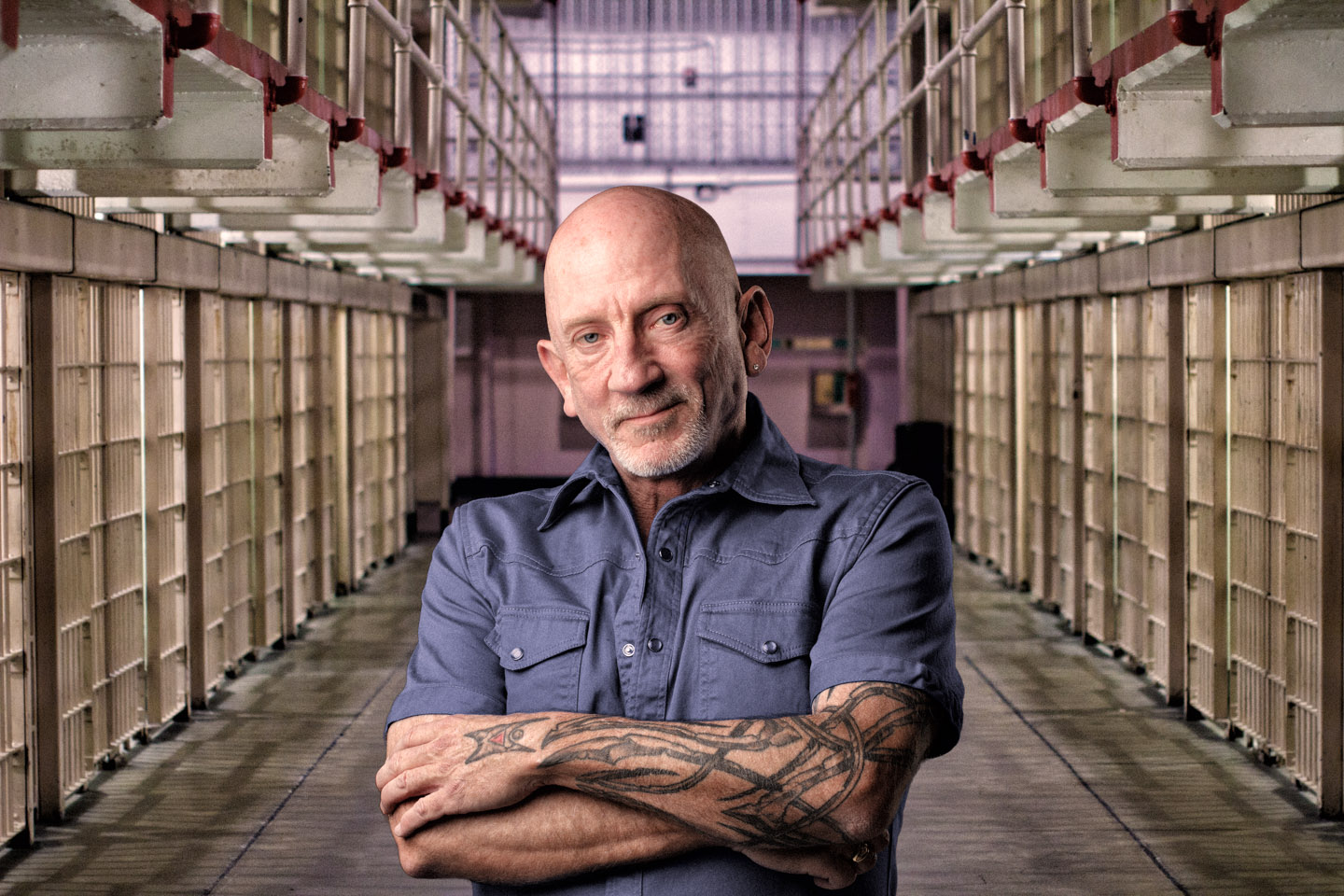 Tough guy with tattoos photoshopped into Alcatraz
