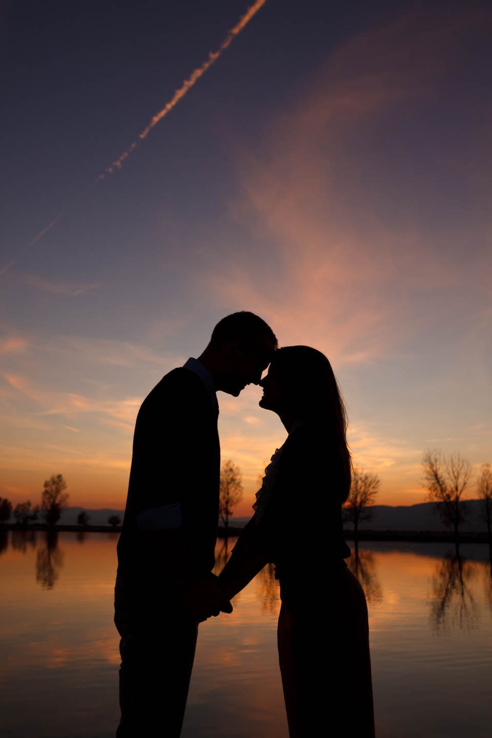 A silhouette of the couple at Utah Lake Marina