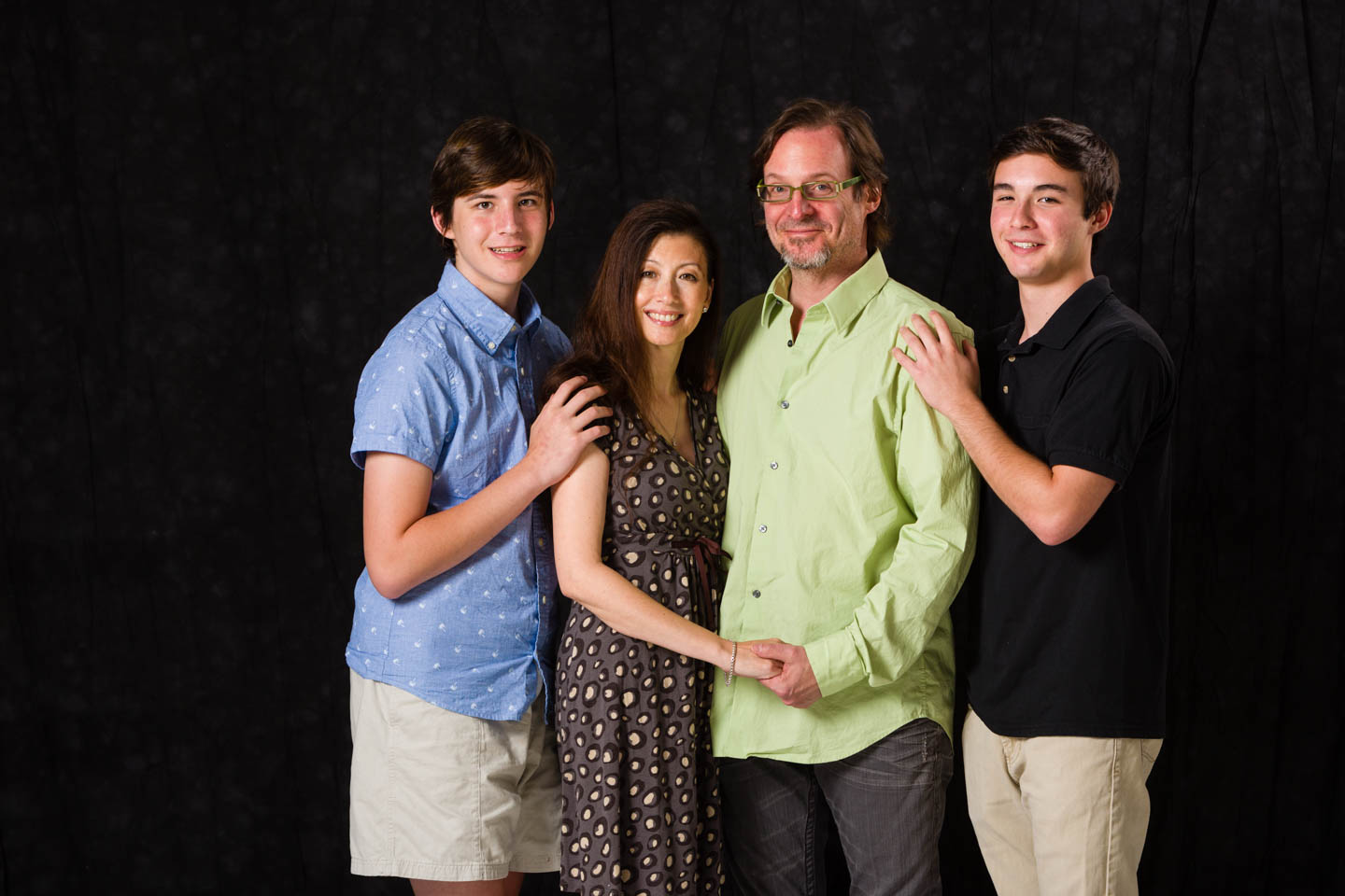 Family portrait in studio with black background