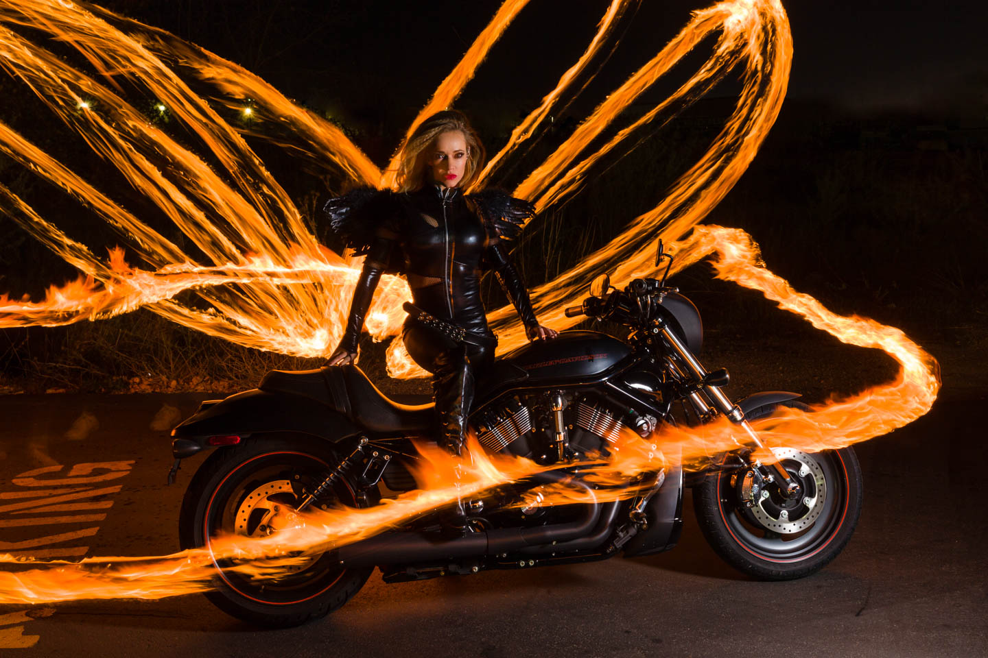 Woman on a motorcycle surrounded by fire