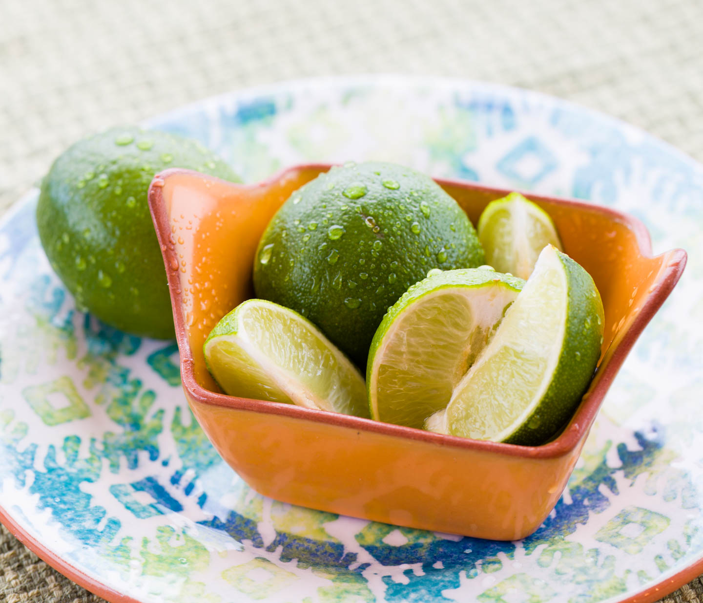 Sliced limes with water drops