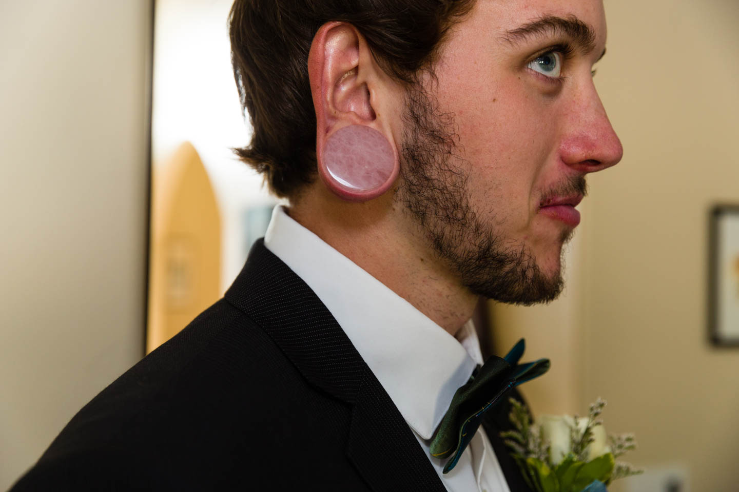 Groom's gauged earring