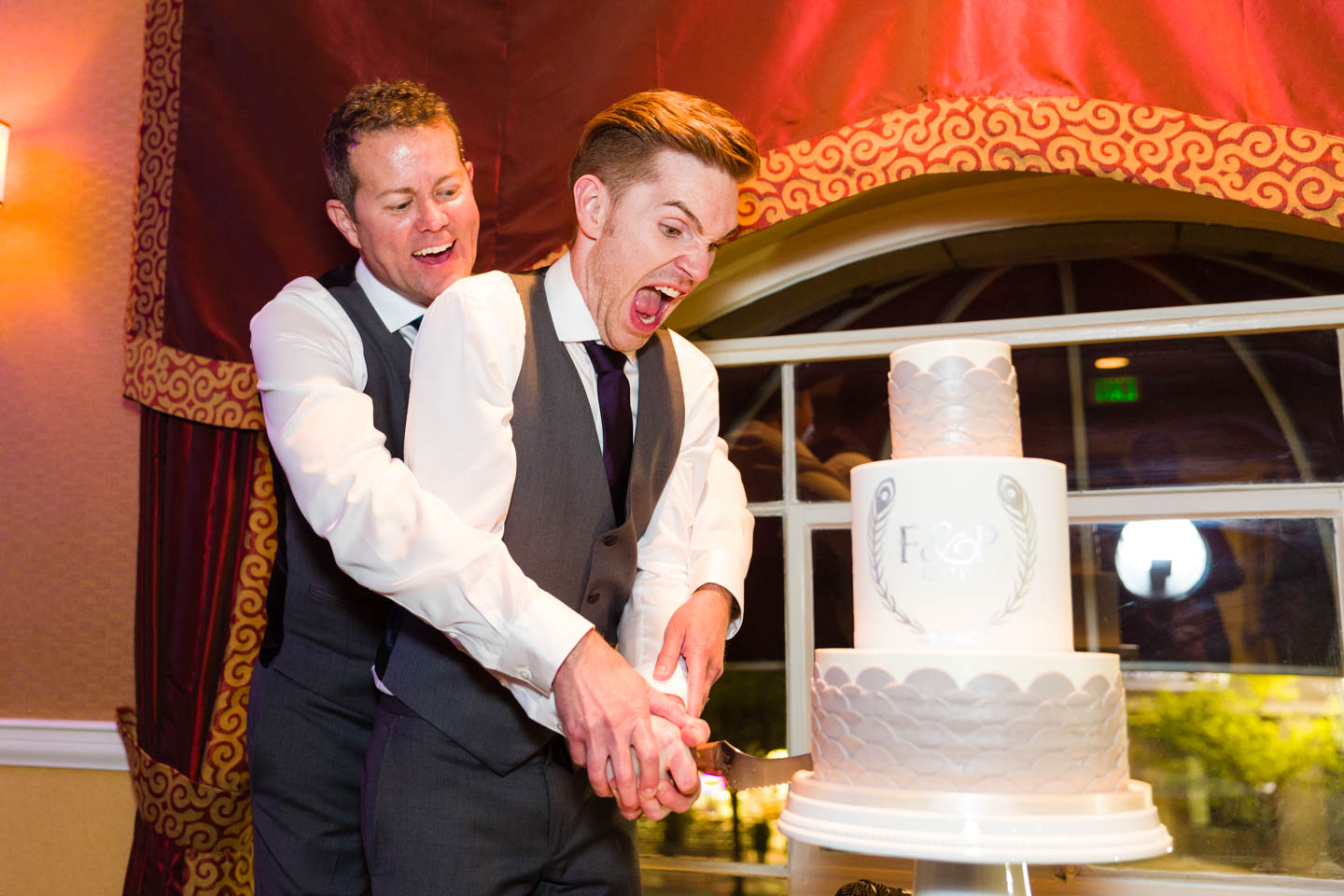 Grooms cut wedding cake