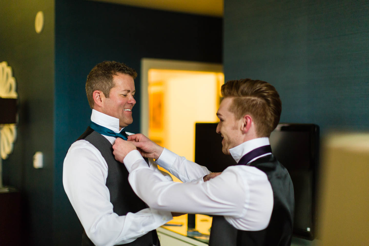 Grooms fix each other's tie
