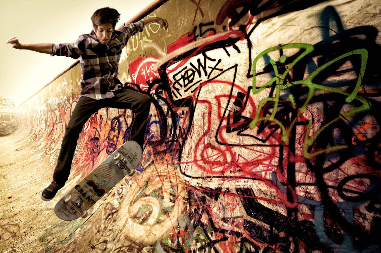 Skateboarder photoshopped into a graffiti laced half pipe