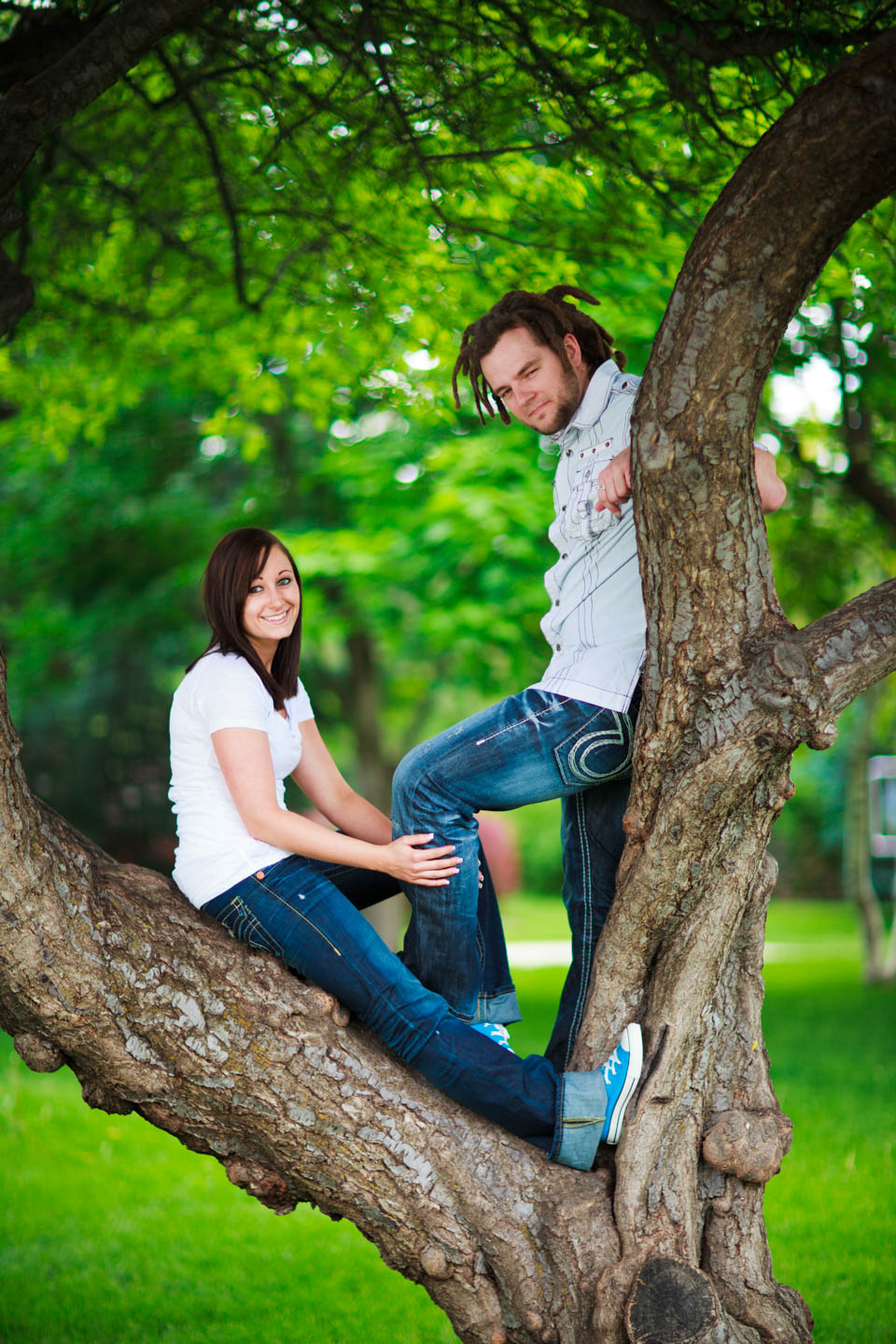Climbing a tree for engagement photos